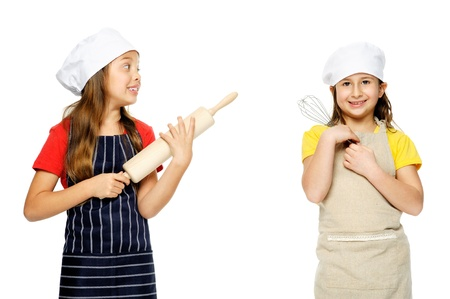 fun background: child chef girl cooks friends playing kitchen together having fun isolated on white background.