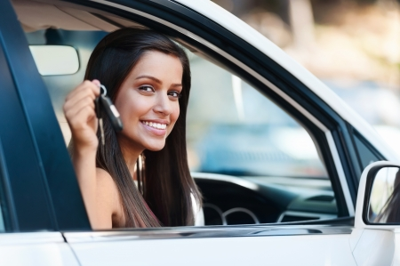 woman driving car: happy learner driver young girl smiling portrait with car keys Stock Photo