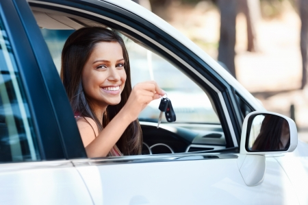happy learner driver young girl smiling portrait with car keys Stock Photo