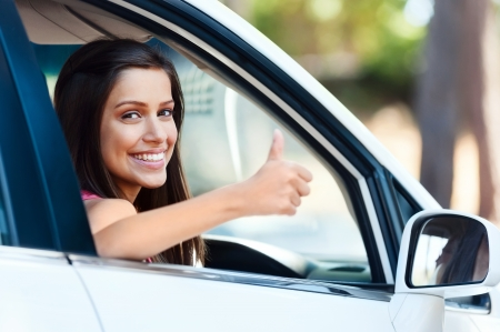 carefree woman in car driving with smile and confidence Stock Photo