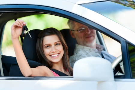 instructor: driving instructor teaching student learner driver Stock Photo
