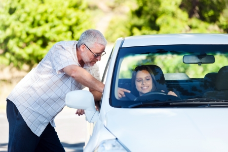 learner: driving instructor teaching student learner driver Stock Photo