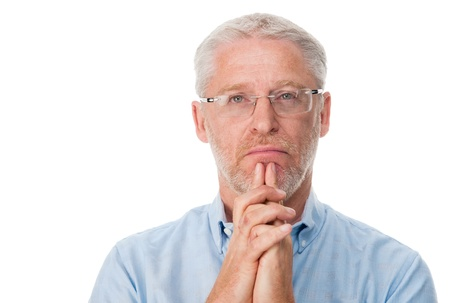 one mid adult male: Mature man thinking isolated on white background