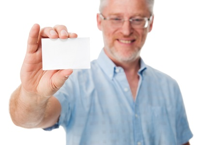businesscard: mature experienced businessman showing businesscard to camera Stock Photo