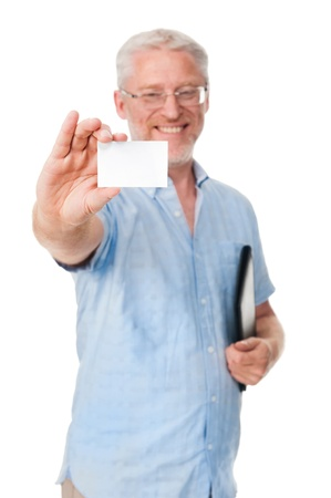 mature experienced businessman showing businesscard to camera Stock Photo - 17573854