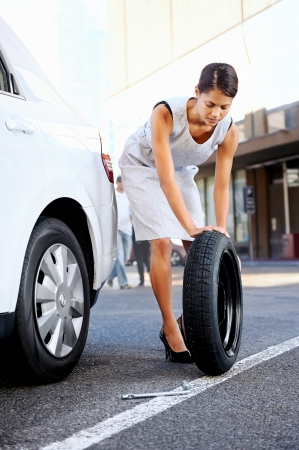 businesswoman in the city with flat tire frustrated Stock Photo - 17636292