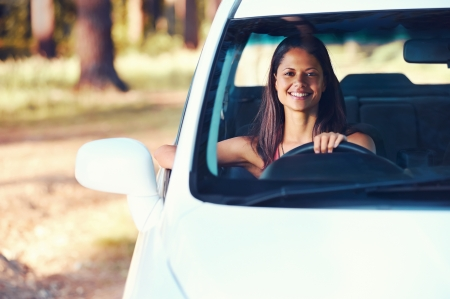 car driving: carefree woman driving car on vacation happy smile holiday Stock Photo