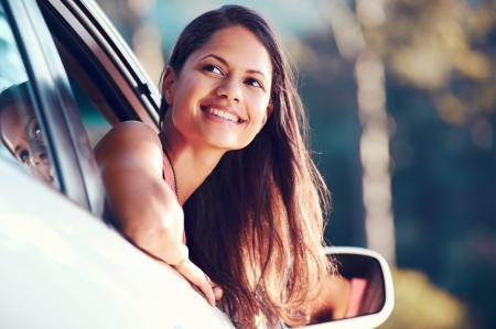 woman driving car: carefree woman driving car on vacation happy smile holiday Stock Photo