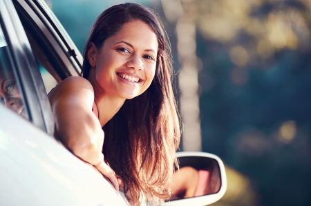 carefree woman driving car on vacation happy smile holiday Stock Photo
