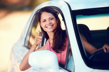 roadtrip: carefree woman driving car on vacation happy smile holiday Stock Photo