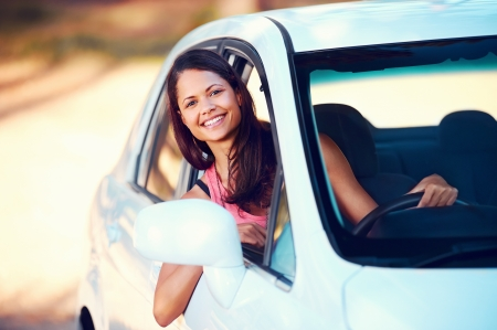 carefree woman driving car on vacation happy smile holiday photo