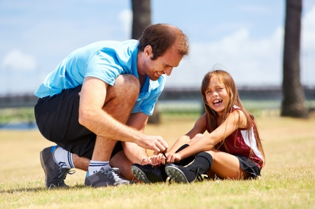 affectionate actions: soccer dad and daughter practising in the field healthy sporty lifestyle