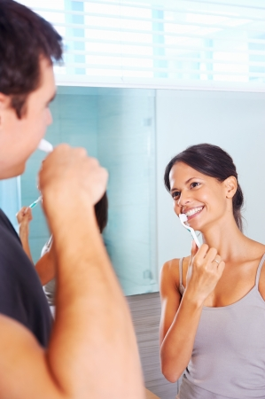 carefree real couple brushing teeth in the bathroom together. daily routine dental health Stock Photo - 18350881