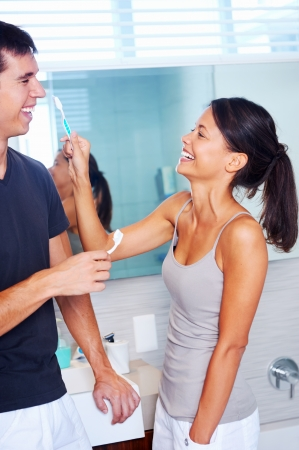 carefree real couple brushing teeth in the bathroom together. daily routine dental health Stock Photo - 18350858