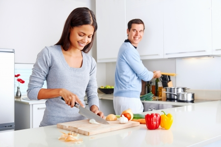 cook house: couple cooking healthy food in kitchen lifestyle meal preparation Stock Photo