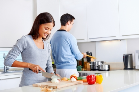 kitchen apron: couple cooking healthy food in kitchen lifestyle meal preparation Stock Photo
