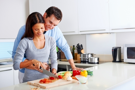 romantic dinner: couple cooking healthy food in kitchen lifestyle meal preparation Stock Photo