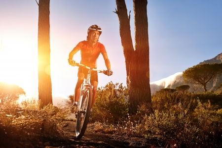Mountain Bike cyclist riding single track at sunrise. healthy lifestyle mountainbike sport. Stock Photo - 18630263