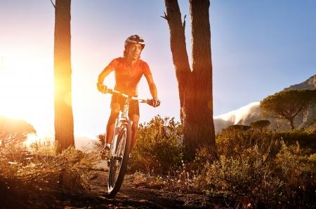 single track: Mountain Bike cyclist riding single track at sunrise. healthy lifestyle mountainbike sport.