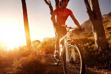Mountain Bike cyclist riding single track at sunrise healthy lifestyle active athlete doing sport Stock Photo - 18630264