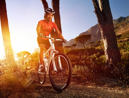 Mountain Bike cyclist riding single track at sunrise healthy lifestyle active athlete doing sport Stock Photo - 18630267