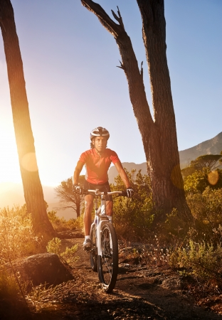 Mountain Bike cyclist riding single track at sunrise healthy lifestyle active athlete doing sport Stock Photo - 18630266