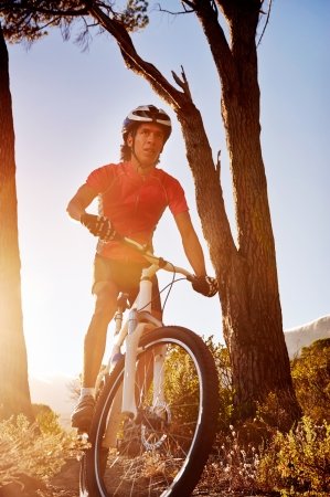 Mountain Bike cyclist riding single track at sunrise healthy lifestyle active athlete doing sport Stock Photo - 18616707