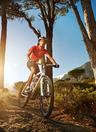 Mountain Bike cyclist riding single track at sunrise healthy lifestyle active athlete doing sport Stock Photo - 18630271