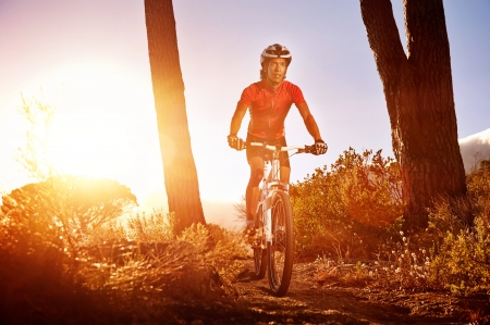 Mountain Bike cyclist riding single track at sunrise healthy lifestyle active athlete doing sport Stock Photo - 18630268
