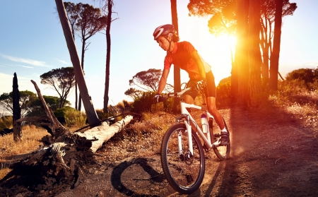 Mountain Bike cyclist riding single track at sunrise healthy lifestyle active athlete doing sport photo