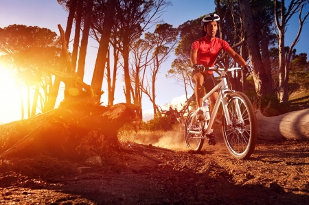 Mountain Bike cyclist riding single track at sunrise healthy lifestyle active athlete doing sport Stock Photo - 18630270