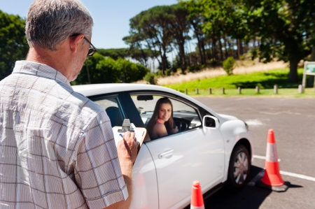 learner: Learner driver girl with intstructor taking lessons Stock Photo