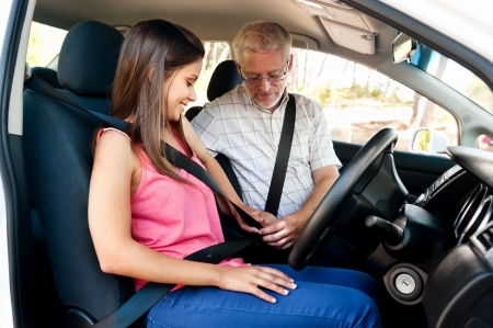 seatbelt: Learner driver girl with intstructor taking lessons Stock Photo