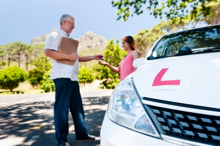 Learner driver girl with intstructor taking lessons Stock Photo