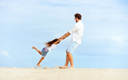 Healthy father and daughter playing together at the beach carefree happy fun smiling lifestyle Stock Photo - 18787774