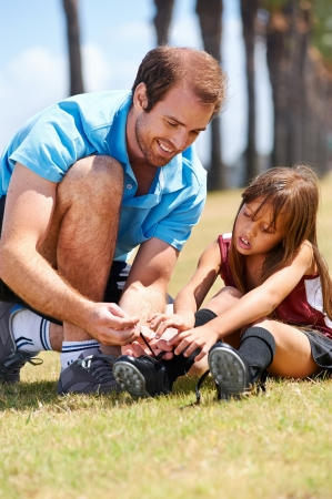 soccer dad and daughter practising in the field healthy sporty lifestyle photo