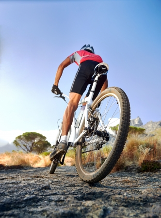 mountain bicycle: Extreme mountain bike sport athlete man riding outdoors lifestyle trail Stock Photo