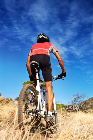 mountain bike man with blue sky riding on outdoor trail in nature Stock Photo - 18911511