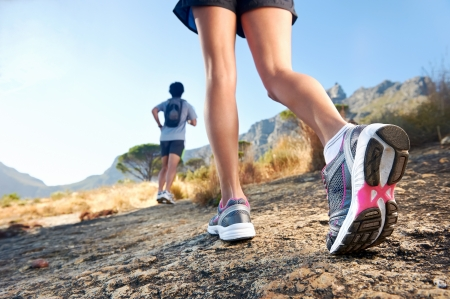 trail running marathon fitness feet on rock fitness and healthy lifestyle photo