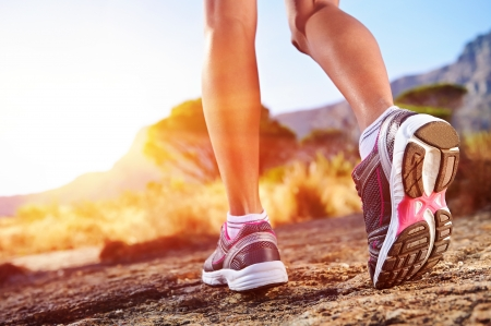 woman running: athlete running sport feet on trail healthy lifestyle fitness