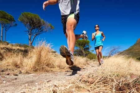 marathon running athletes couple training on trail fitness sport active lifestyle Stock Photo