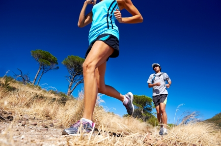 marathon running athletes couple training on trail fitness sport active lifestyle Фото со стока