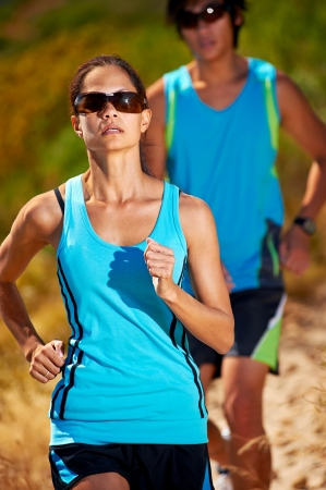 couple running together training for marathon and fitness photo