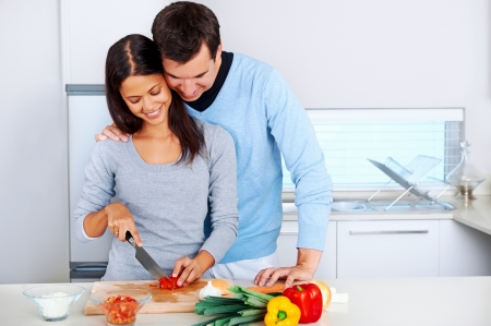 couple prepare food together in kitchen. healthy lifestyle relationship photo
