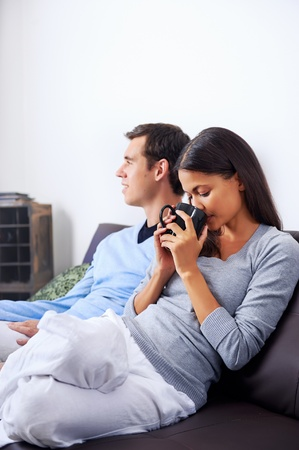 Couple relax at home with cup of coffee and sofa couch. happy healthy relationship Stock Photo - 19109397