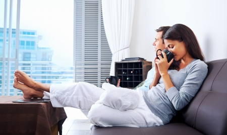Couple relax at home with cup of coffee and sofa couch. happy healthy relationship Stock Photo - 19124543
