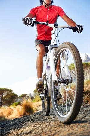 Extreme mountain bike sport athlete man riding outdoors lifestyle trail Foto de archivo