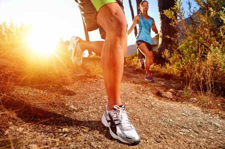 athletic body: Trail running marathon athlete outdoors sunrise couple training for fitness and healthy lifestyle