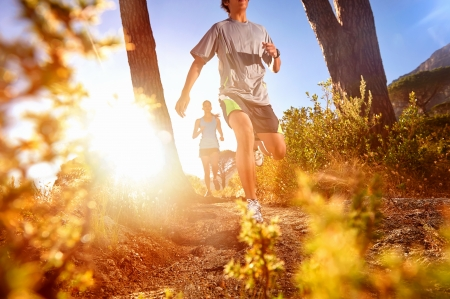 outdoor sports: Trail running marathon athlete outdoors sunrise couple training for fitness and healthy lifestyle