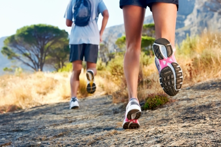 trail: trail running marathon fitness feet on rock fitness and healthy lifestyle